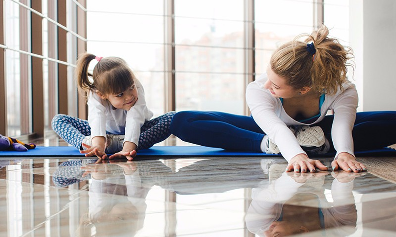 Mother and daughter streching