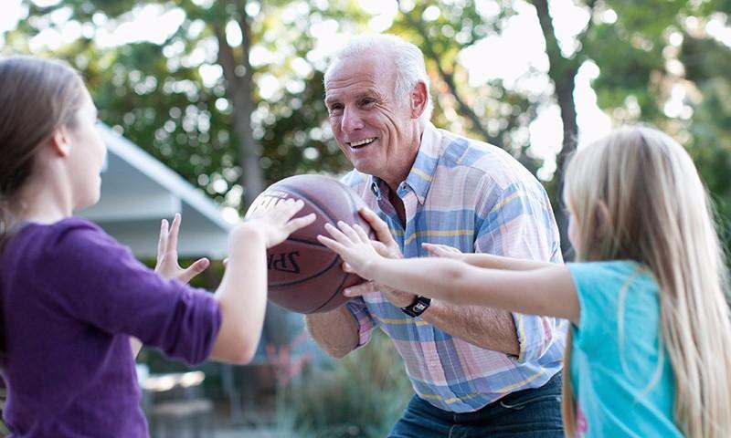 Grandpa and kids playing hoops