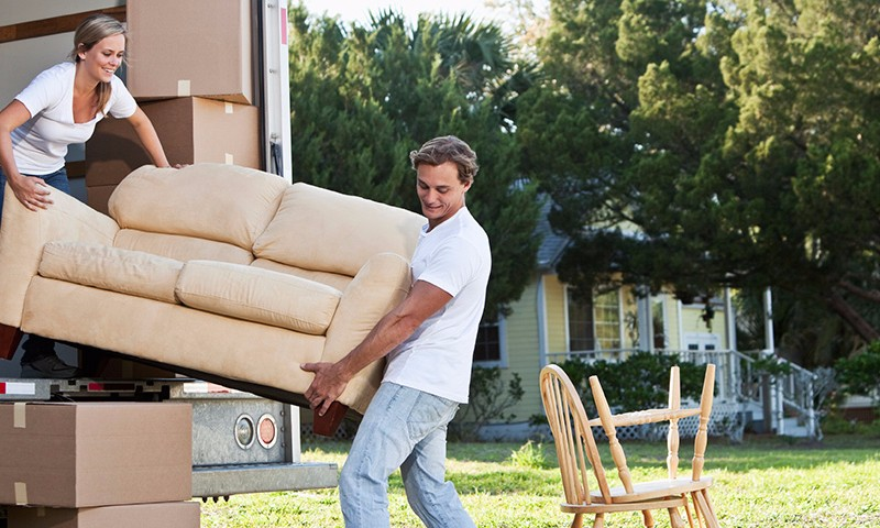Couple moving furniture